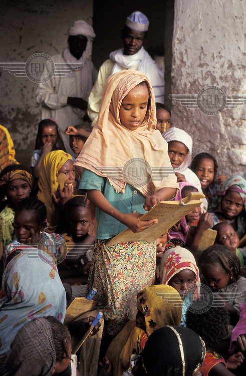 A young girl is reading aloud at the Koranic school which she attends.
