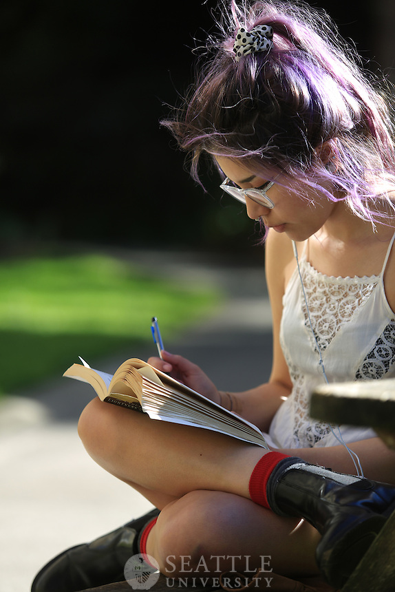 March 30th, 2016- Jessica Martinez, a sophomore Communications Studies major at Seattle University enjoys the sunny afternoon by reading a book behind Seattle U's Administration building.
