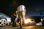 Palm Springs Police Officer Simon Min, left, gives a field sobriety test to a driver who Min suspects has had too much to drink in Palm Springs on Wednesday, April 2, 2008. Min originally stopped the driver for a burned out headlight. After passing the Breathalyzer test, Min let the driver go free. Min has recently received a statewide award from Mothers Against Drunk Driving for his diligence in getting drunk drivers off the road.