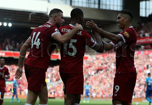 27th August 2017, Anfield, Liverpool, England; EPL Premier League football, Liverpool versus Arsenal; Daniel Sturridge  celebrates his goal in the 77th minute with team mates Jordan Henderson and Roberto Firmino giving Liverpool a 4-0 lead