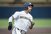 Michigan Wolverines outfielder Jonathan Engelmann (2) rounds third base against the Michigan State Spartans on May 19, 2017 at Ray Fisher Stadium in Ann Arbor, Michigan. Michigan defeated Michigan State 11-6. (Andrew Woolley/Four Seam Images)