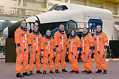 Houston, TX - (FILE) -- The STS-125 crewmembers take a moment to pose for a crew photo on June 4, 2008 prior to a training session in the Space Vehicle Mockup Facility at NASA's Johnson Space Center. From the left are astronauts Michael J. Massimino, Michael T. Good, both mission specialists; Gregory C. Johnson, pilot; Scott D. Altman, commander; K. Megan McArthur, John M. Grunsfeld and Andrew J. Feustel, all mission specialists. The crewmembers are wearing training versions of their shuttle launch and entry suits.  The STS-125 crew is scheduled to launch Monday, May 11, 2009 at 2:01 p.m. EDT aboard the Space Shuttle Atlantis for a mission to service the Hubble Space Telescope..Credit: NASA via CNP