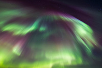 The northern lights burst into a colorful display during a night of high aurora activity in the White Mountains Recreation Area in Alaska's interior. March 17, 2013 Aurora corona as seen when standing directly below a bundle of parallel plasma-channeling magnetic field lines that are converging on a point high in the sky.