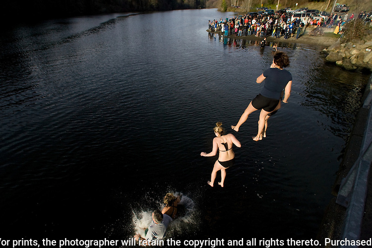 Participants in the 28th annual Polar Bear leap into the Burley Lagoon in Olalla, Washington on January 1, 2012. Over 500 hardy participants  braved the chilly lagoon waters to join in on the annual New Year's Day Tradition.  ©2012. Jim Bryant. All Rights Reserved.