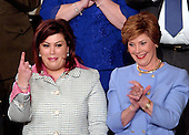 Washington, D.C. - February 2, 2005 -- Safia Taleb al-Suhail, special guest of first lady Laura Bush, left, holds up her index finger as Mrs. Bush, right, looks on during the State of the Union Address at the Capitol in Washington, D.C. on February 2, 2005.<br /> Credit: Ron Sachs / CNP
