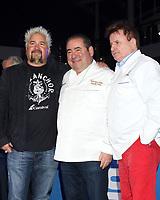 LOS ANGELES - DEC 10:  Guy Fieri, Emeril Lagasse, Rudi Sodamin at the Carnival Panorama Press Day at Long Beach Carnival Cruise Terminal on December 10, 2019 in Long Beach, CA