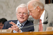 Washington, D.C. - April 19, 2007-- United States Senator Joe Biden (Democrat of Delaware), right, and United States Senator Ted Kennedy (Democrat of Massachusetts),left, discuss the testimony of United States Attorney General Alberto Gonzalez during the hearing before the United States Senate Judiciary Committee for the Attorney General to explain the controversial removal of several United States Attorneys on Capitol Hill in Washington, D.C. on Thursday, April 19, 2007.<br /> Credit: Ron Sachs / CNP