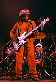 PETER TOSH - bassist Robbie Shakespeare - performing live in concert with Peter Tosh on the Wanted Dead or Alive Tour at the Rainbow Theatre in Finsbury Park London UK - 30 Jun 1981.  Photo by: George Chin/IconicPix