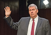 "J. Michael Pearson, Chief Executive Officer, Valeant Pharmaceuticals International, Inc; is sworn-in to give testimony before the United States Senate Committee on Aging hearing on ""Valeant Pharmaceuticals' Business Model: the Repercussions for Patients and the Health Care System"" on Capitol Hill in Washington, DC on Wednesday, April 27, 2016.  Valeant raised the price of four life-saving drugs: Isuprel by about 720 percent; Nitropress by 310 percent; Cuprimine by 5,878 percent, and Syprine by 3,162 percent after acquiring them in 2015. It is the high prices that are now at the heart of two congressional probes.<br /> Credit: Ron Sachs / CNP"
