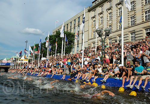 12 JUL 2014 - HAMBURG, GER - Competitors head for the swim exit at the end of the elite men's 2014 ITU World Triathlon Series round in the Altstadt Quarter, Hamburg, Germany (PHOTO COPYRIGHT © 2014 NIGEL FARROW, ALL RIGHTS RESERVED)