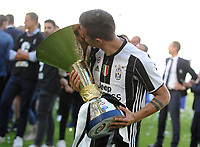 Calcio, Serie A: Juventus vs Crotone. Torino, Juventus Stadium, 21 maggio 2017.<br /> Juventus&rsquo; Paulo Dybala kisses the trophy during the celebrations for the victory of the sixth consecutive Scudetto at the end of the Italian Serie A football match between Juventus and Crotone at Turin's Juventus Stadium, 21 May 2017. Juventus defeated Crotone 3-0.<br /> UPDATE IMAGES PRESS/Manuela Viganti
