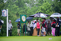 Kris Tamulis (USA), Christina Kim (USA), and Ai Miyazato (JPN) attempt to stay dry on the first tee before Friday's second round of the 72nd U.S. Women's Open Championship, at Trump National Golf Club, Bedminster, New Jersey. 7/14/2017.<br /> Picture: Golffile | Ken Murray<br /> <br /> <br /> All photo usage must carry mandatory copyright credit (&copy; Golffile | Ken Murray)