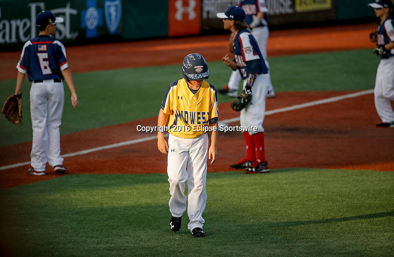 ABERDEEN, MD - AUGUST 02: Finn O'Connor #11 of Southeast Denver (CO) walks back to the dugout after being tagged out at third base to end the inning in a game between New England and Midwest Plains during the Cal Ripken World Series at The Ripken Experience Powered by Under Armour on August 2, 2016 in Aberdeen, Maryland. (Photo by Ripken Baseball/Eclipse Sportswire/Getty Images)