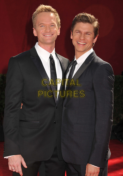 NEIL PATRICK HARRIS & DAVID BURTKA .Attending the 61st Annual Primetime Emmy Awards held at NOKIA Theatre L.A. LIVE, Los Angeles, California, USA, .20th September 2009..emmys arrivals half length suit couple black tie .CAP/ADM/BP.©Byron Purvis/Admedia/Capital Pictures