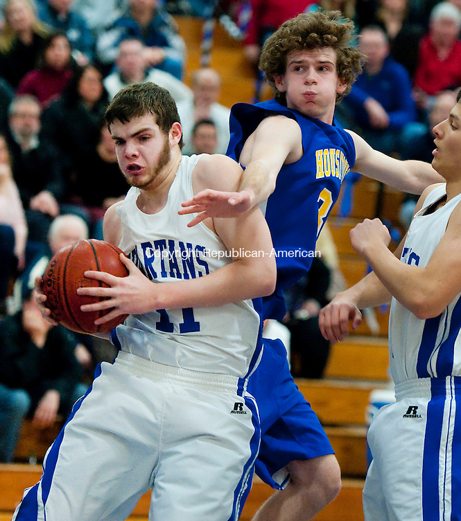 BURLINGTON,  CT-021315JS07- Lewis Mills' Trent Millum (11) pulls down a rebound in front of Housatonic's Justin Dean (32) during their game Friday at Lewis Mills High School in Burlington. <br />  Jim Shannon Republican-American