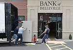 Employees of Huffman Security, out of Arnold, Missouri, push and pull on a Porta-Vault as they moved bank vaults, cabinets, safety deposit boxes and more from the old site of Bank of Belleville to their new location at 215 South Illinois Street. This heavy metal security vault weighs about 3,500 pounds, and took five men (one is behind it and not shown) to move it into position. Belleville police officers were helping guard both the old and new banks, and accompanied each of the Huffman moving trucks on the road. The bank boasts the newest high-tech security and energy conservation systems, and has redundant power supplies in case of a power outage. The bank will open for business at the drive-thru windows at 7:45 a.m. on Monday, and the lobby opens at 9 a.m. -- regular banking hours.