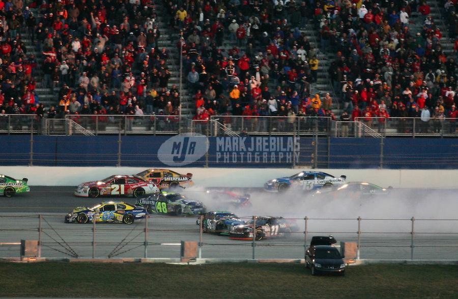 Feb 18, 2007; Daytona, FL, USA; Nascar Nextel Cup Series driver Jimmie Johnson (48) Jeff Green (66) Tony Raines (96) Denny Hamlin (11) and David Reutimann (00) crash during the Daytona 500 at Daytona International Speedway. Mandatory Credit: Mark J. Rebilas