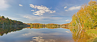 Council Lake reflects blues skies and puffy white clouds on an autumn afternoon, Hiawatha National Forest, Alger County, Michigan