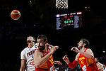Spain´s Marc Gasol (R) and Pau Gasol (L) and France´s Gobert during FIBA Basketball World Cup Spain 2014 match between Spain and France at `Palacio de los deportes´ stadium in Madrid, Spain. September 10, 2014. (Victor Blanco)