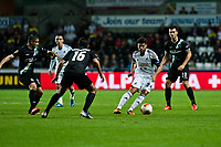 Thursday  03 October  2013  Pictured:Alejandro Pozuelo of Swansea ( with the ball )  breaks the of St.Gallen defence<br /> Re:UEFA Europa League, Swansea City FC vs FC St.Gallen,  at the Liberty Staduim Swansea