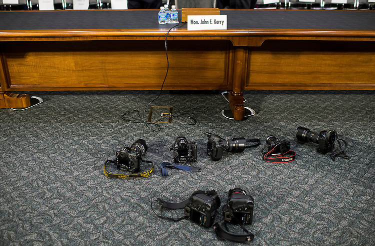 """UNITED STATES - DECEMBER 9: Cameras mark photographers' position for the arrival of Secretary of State John Kerry at the Senate Foreign Relations Committee hearing on """"Authorization for the Use of Military Force Against ISIL"""" on Tuesday, Dec. 9, 2014. (Photo By Bill Clark/CQ Roll Call)"""