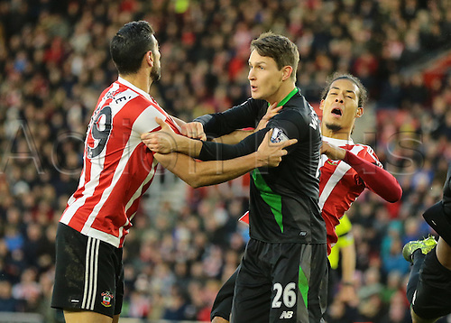 21.11.2015. St Marys Stadium, Southampton, England. Barclays Premier League. Southampton versus Stoke City. Virgil Van Dijk  and Jay Rodriguez of Southampton get to grips with each other in the Stoke City area while Defender Philipp Wollscheid covers during a Southampton corner