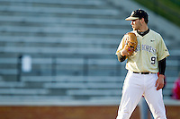 Wake Forest Demon Deacons starting pitcher Austin Stadler (9) looks to his catcher for the sign against the North Carolina State Wolfpack at Wake Forest Baseball Park on March 15, 2013 in Winston-Salem, North Carolina.  The Wolfpack defeated the Demon Deacons 12-6.  (Brian Westerholt/Four Seam Images)