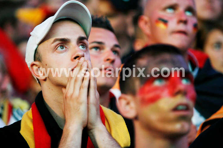 **ALL ROUND PICTURES FROM SOLARPIX.COM**.**SYNDICATION RIGHTS FOR UK AND SPAIN ONLY**.Football European Championship 2008 Austria/Switzerland, final, Match 31, Germany vs Spain, 29 June 2008, public viewing in Hanover. .German supporters grieve after the match the match ended 0-1...JOB REF:6747-CPR/Nigel Treblin        DATE:29-06_08.**MUST CREDIT SOLARPIX.COM OR DOUBLE FEE WILL BE CHARGED* *UNDER NO CIRCUMSTANCES IS THIS IMAGE TO BE REPRODUCED FOR ANY ONLINE EDITION WITHOUT PRIOR PERMISSION*