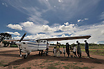 Residents of the village of Luena, in the Democratic Republic of the Congo, gather near a plane from the Wings of the Morning aviation ministry of The United Methodist Church.