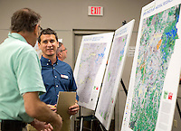 NWA Democrat-Gazette/JASON IVESTER <br /> Jason Reyes with Alta Planning &amp; Design talks with Bruce Pertle (cq) (left) of Rogers on Wednesday, Sept. 23, 2015, during a workshop for Northwest Arkansas regional Open Space Plan inside the Rogers Public Library.