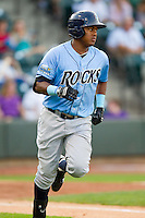 Daniel Mateo (16) of the Wilmington Blue Rocks hustles down the first base line against the Winston-Salem Dash at BB&T Ballpark on August 3, 2013 in Winston-Salem, North Carolina.  The Blue Rocks defeated the Dash 4-2.  (Brian Westerholt/Four Seam Images)