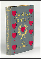 BNPS.co.uk (01202)558833<br /> Pic:  SwannAuctionGalleries/BNPS<br /> <br /> A first edition of Casino Royale (1953), the first James Bond book, is set to sell for £14,000 ($18,000).<br /> <br /> A single owner collection of historic James Bond first editions inscribed by Ian Fleming have emerged for sale for £55,000. ($70,000)<br /> <br /> The marquee lot is a first edition of Goldfinger (1959) given by the author to legendary golfer Sir Henry Cotton, who won The Open three times.<br /> <br /> Fleming references the chapters containing the classic golf match between Bond and the villain Auric Goldfinger, whose caddy was Oddjob, in the book.<br /> <br /> The collection of 13 books is being sold by a private collector with US based Swann Auction Galleries.