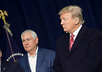 United States Secretary of State Rex Tillerson, left, listens as Republicans take turns speaking to the media at Camp David, the presidential retreat near Thurmont, Maryland, after US President Donald J. Trump, right, held meetings for Cabinet members and Republican members of Congress to discuss the Republican legislative agenda for 2018 on January 6, 2018.<br /> CAP/MPI/RS<br /> &copy;RS/MPI/Capital Pictures