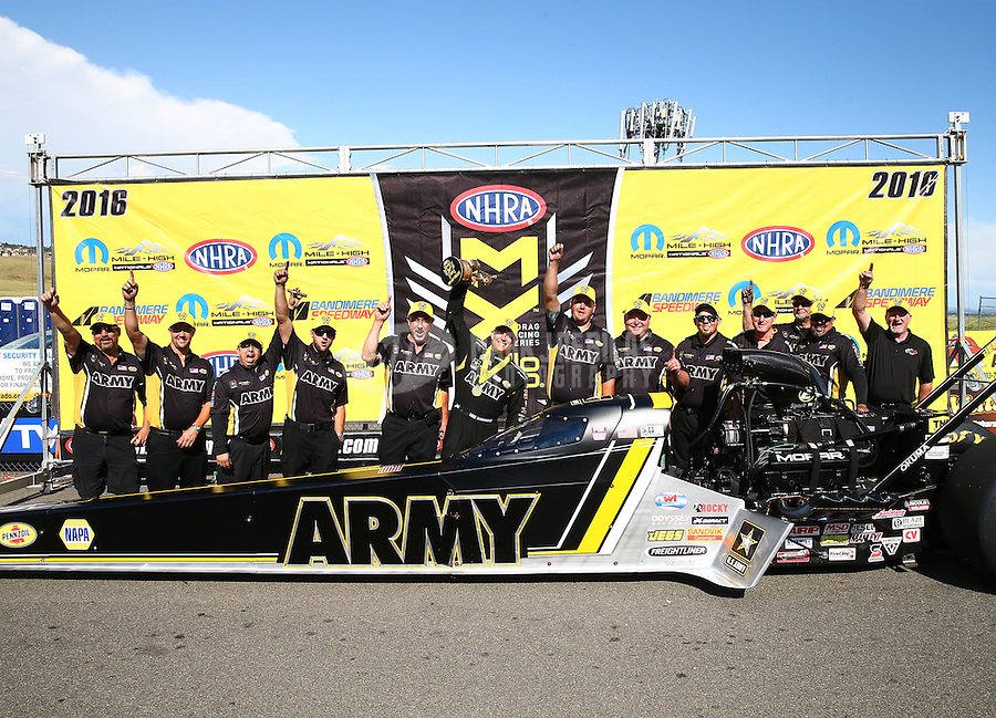 Jul 24, 2016; Morrison, CO, USA; NHRA top fuel driver Tony Schumacher celebrates with crew after winning the Mile High Nationals at Bandimere Speedway. Mandatory Credit: Mark J. Rebilas-USA TODAY Sports