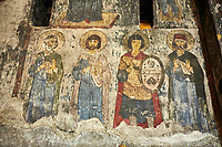 Picture &amp; image of Vardzia medieval cave Church of the Dormition interior secco paintings, part of the cave city and monastery of Vardzia, Erusheti Mountain, southern Georgia (country)<br /> <br /> Inhabited from the 5th century BC, the first identifiable phase of building took place at  Vardzia in the reign of Giorgi III (1156-1184) to be continued by his successor, Queen Tamar 1186, when the Church of the Dormition was carved out of the rock and decorated with frescoes