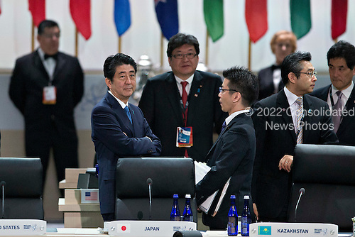 """Shinzo Abe, Japan's prime minister, left, waits to begin an opening plenary entitled """"National Actions to Enhance Nuclear Security""""at the Nuclear Security Summit in Washington, D.C., U.S., on Friday, April 1, 2016. After a spate of terrorist attacks from Europe to Africa, U.S. President Barack  Obama is rallying international support during the summit for an effort to keep Islamic State and similar groups from obtaining nuclear material and other weapons of mass destruction. <br /> Credit: Andrew Harrer / Pool via CNP"""