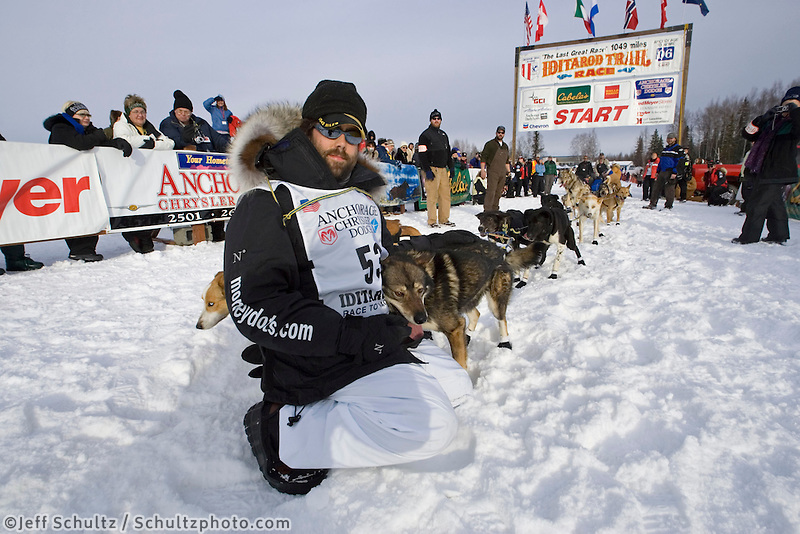 Rick Casillo checks his team one last time @ start line 2006 Iditarod Restart Willow Alaska Winter