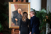 US President Donald J. Trump (R) and First Lady Melania Trump (L) pause in front of a portrait of late US Supreme Court Justice John Paul Stevens as he lies in repose in the Great Hall of the Supreme Court, in Washington, DC, USA, 22 July 2019. Stevens, who served on the Supreme Court for nearly thirty-five years, died at age ninety-nine, 16 July.<br /> Credit: Michael Reynolds / Pool via CNP