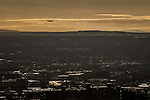 © Joel Goodman - 07973 332324 . 07/12/2013 . View over south Manchester with an aeroplane coming in to land at Manchester Airport . Cityscape view of Manchester . Photo credit : Joel Goodman