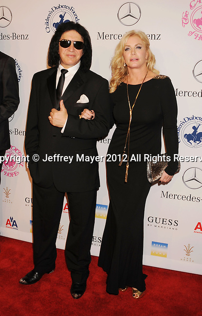 BEVERLY HILLS, CA - OCTOBER 20: Shannon Tweed and Gene Simmons arrive at the 26th Anniversary Carousel Of Hope Ball presented by Mercedes-Benz at The Beverly Hilton Hotel on October 20, 2012 in Beverly Hills, California.