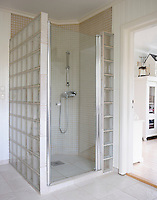 A spacious shower unit constructed of thick glass bricks