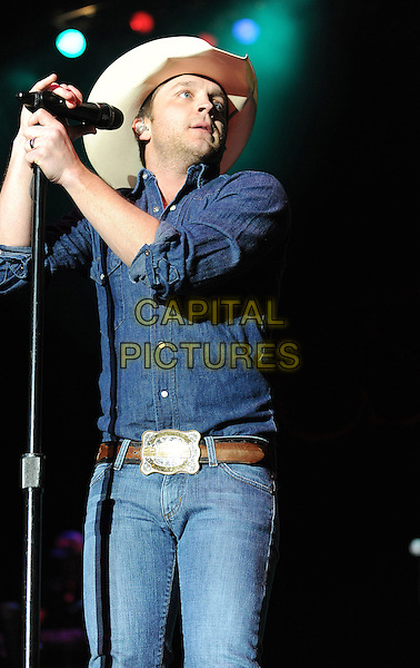 JUSTIN MOORE.Singer Justin Moore performs live at the 2011 Winterblast at the Hampton Coliseum, Hampton, Virginia, USA,  .29th January 2011..half  length country music stage gig jeans shirt denim double cowboy hat microphone .CAP/ADM/MOO.© Moose/AdMedia/Capital Pictures.