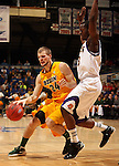 SIOUX FALLS, SD - MARCH 11:  Taylor Braun #24 from North Dakota State University drives against Adam Link #33 from Western Illinois University in the second half or their semifinal game Monday night at the 2013 Summit League Championship in Sioux Falls, SD.  (Photo by Dave Eggen/Inertia)