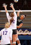 BROOKINGS, SD - NOVEMBER 9:  Mikala Hora #14 from South Dakota State University goes for a kill past Mallory Gibson #12 from Western Illinois in the first game of their match Saturday at Frost Arena. (Photo by Dave Eggen/Inertia)