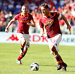 Calcio, Serie A: Roma vs Bologna. Roma, stadio Olimpico, 16 settembre 2012..AS Roma forward Francesco Totti in action past teammate Federico Balzaretti, left, during the Italian Serie A football match between AS Roma and Bologna at Rome's Olympic stadium, 16 september 2012..UPDATE IMAGES PRESS/Isabella Bonotto