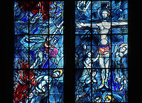 Christ's descent from the cross (left) and the crucifixion (right), stained glass window, 1974, by Marc Chagall, 1887-1985, with the studio of Jacques Simon, in the axial chapel of the apse of the Cathedrale Notre-Dame de Reims or Reims Cathedral, Reims, Champagne-Ardenne, France. The cathedral was built 1211-75 in French Gothic style with work continuing into the 14th century, and was listed as a UNESCO World Heritage Site in 1991. Picture by Manuel Cohen