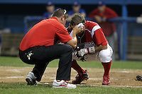 Batavia Muckdogs shortstop Anthony Melchionda #16 is looked at by trainer Mike Petraca after getting hit in the head by a pitch during a game against the Auburn Doubledays at Dwyer Stadium on June 18, 2012 in Batavia, New York.  Auburn defeated Batavia 6-5.  (Mike Janes/Four Seam Images)