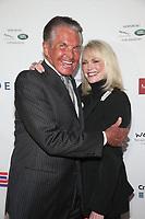 BEVERLY HILLS, CA - NOVEMBER 7: George Hamilton and Kelly Day at the Mark Zunino Atelier Fashion and Cocktail Reception to benefit the Elizabeth Taylor Foundation hosted by Dame Joan Collins on November 7, 2019.        <br /> CAP/MPI/SAD<br /> ©SAD/MPI/Capital Pictures