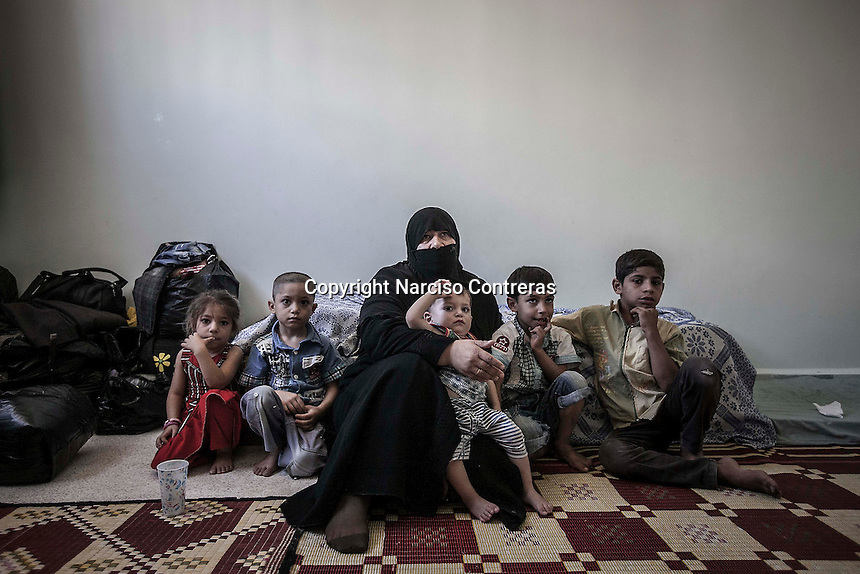 Om Mahmud is a 45 years old woman from Bab Al Nerab in Aleppo City and mother of 20 daughters and sons, due the heavy fighting in the city she and her family have fled into Manbij to take temporary shelter, a city located at the northeast of Aleppo province.