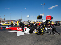 Mar 30, 2014; Las Vegas, NV, USA; Crew members push NHRA top fuel driver Steve Torrence into the water box during the Summitracing.com Nationals at The Strip at Las Vegas Motor Speedway. Mandatory Credit: Mark J. Rebilas-